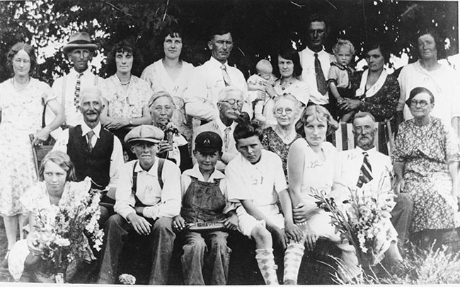 Iris (bottom left) celebrates her 100th birthday on Dec. 15. In the photo she is celebrating the 50th wedding anniversary of Mr. and Mrs. G.R. Hammond . Back row (left to right) Elsie Hammond, Lester Hammond, Ivy Hammond, Phyllis Hammond, Bill Hammond, Sheila Hammond, May Hammond, Edwin Perrin, Wayne Perrin, Lydia Perrin, Doreen Perrin; second row - Bob Perrin, Winnie Hancock, Mr. and Mrs. G.R. Hammond, Ted Perrin, Mrs. Ted Perrin; third row - Iris, Rex Hammond, Lloyd Hammond, Bruce Hammond, Georgina Hammond. Photo contributed