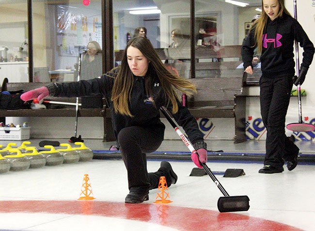 Jayce McCarty, who goes to school in Gull Lake, works on her balance during the Maple Creek Curling Club's Skills Event on Dec. 2. NEWS PHOTO SEAN MCINTOSH